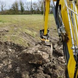 Digger hits rock